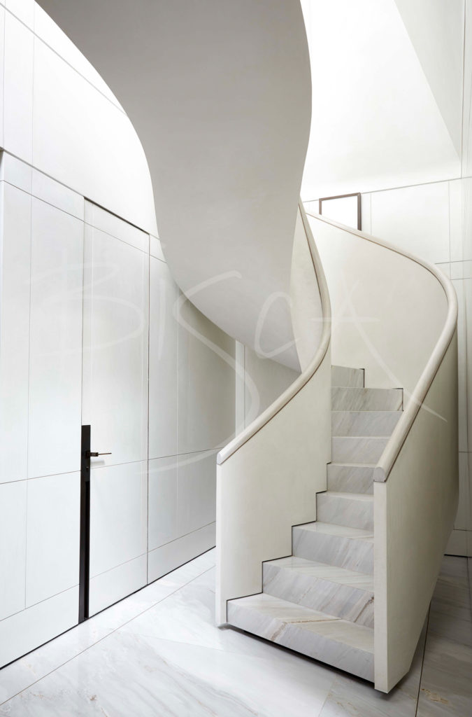 white helical curved spiral staircase