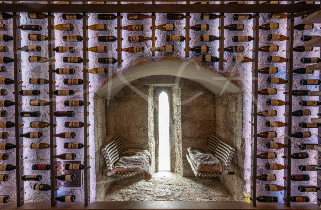 Illuminated-Bespoke-wine-wall-with-sliding-ladder-at-Belvelly-Castle