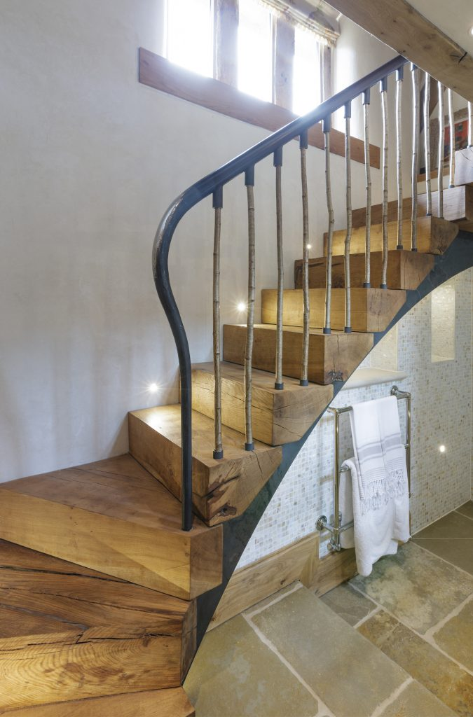 New stairs of a rustic design by Bisca in a mediaevel barn