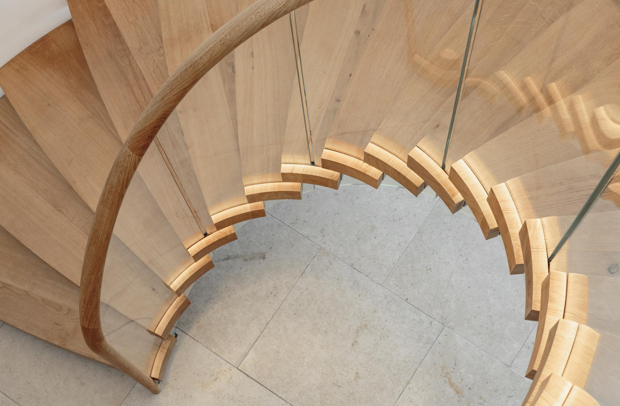 Helical Bisca staircase with stair lighting under the handrail