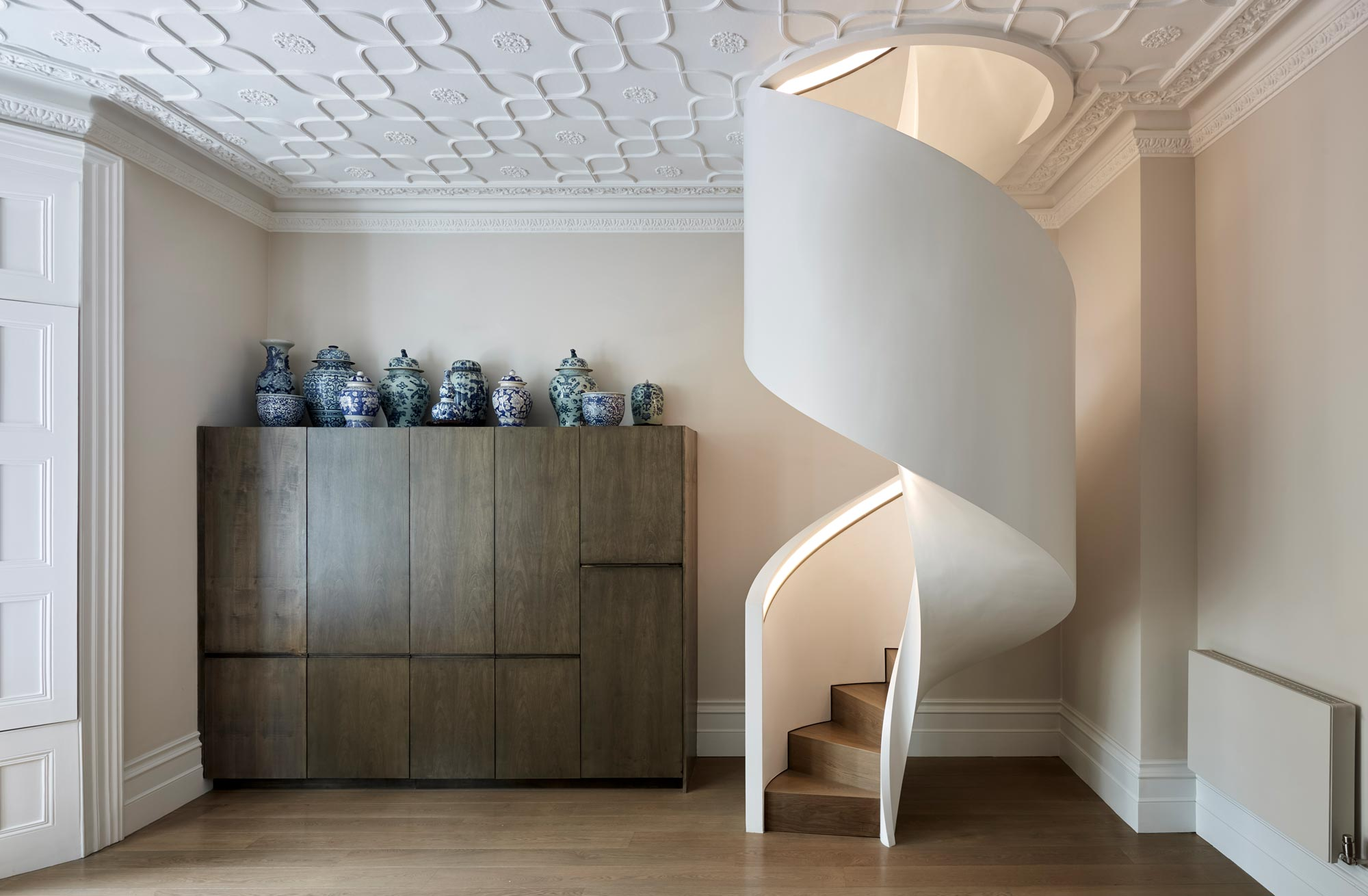 Staircase lighting concealed in the recessed handrail