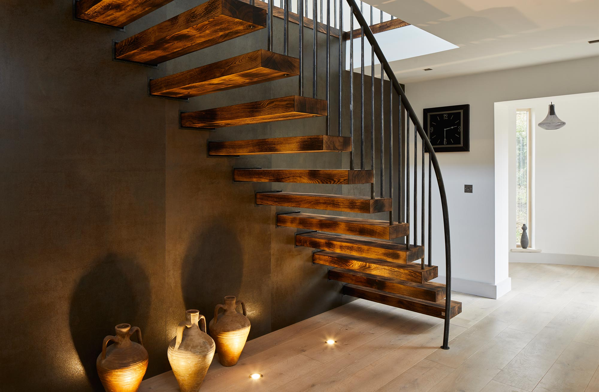 Uplighters under a staircase feature lights